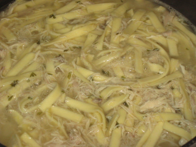 Chicken and Noodles simmering in homemade chicken and broth