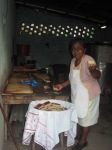 Our Nicaraguan hostess serving corn cake