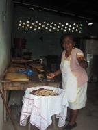 Our Nicaraguan hostess serving corn cake